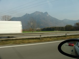 Driving along the Autobahn towards Innsbruck with friends right behind (visible in side-view mirror).
