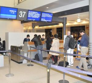 Passengers at a United gate at Narita