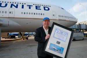 Tom Stuker in front of the 747 that bears his name