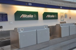 An Alitalia check-in counter in Chicago