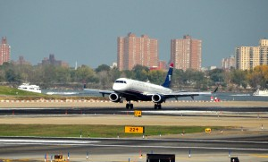 A US Airways jet landing at LaGuardia