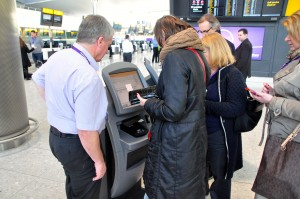 Passengers at a check-in kiosk at Heathrow's Terminal 2