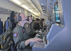 U.S. Navy crew members on a P-8A Poseidon searching for Flight 370