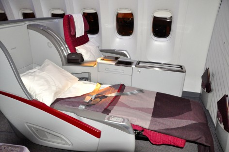 Business-class lie-flat seats on a Qatar 777-300ER
