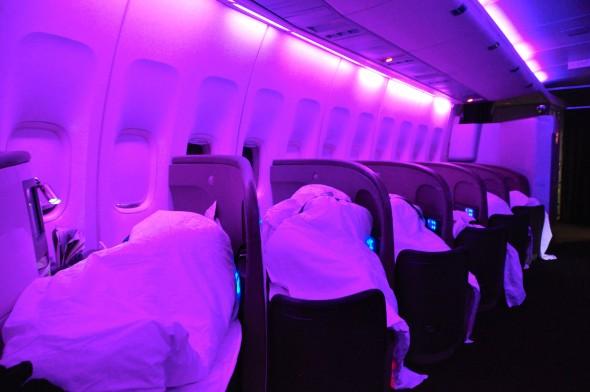 Passengers asleep on Virgin Atlantic's herringbone seats on a 747