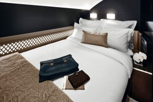 Etihad's Residence suite with double-bed and bath