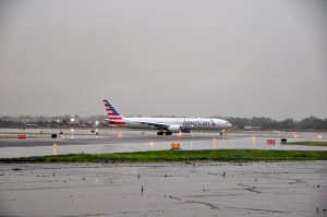 An American Airlines jet taxiing in the rain.