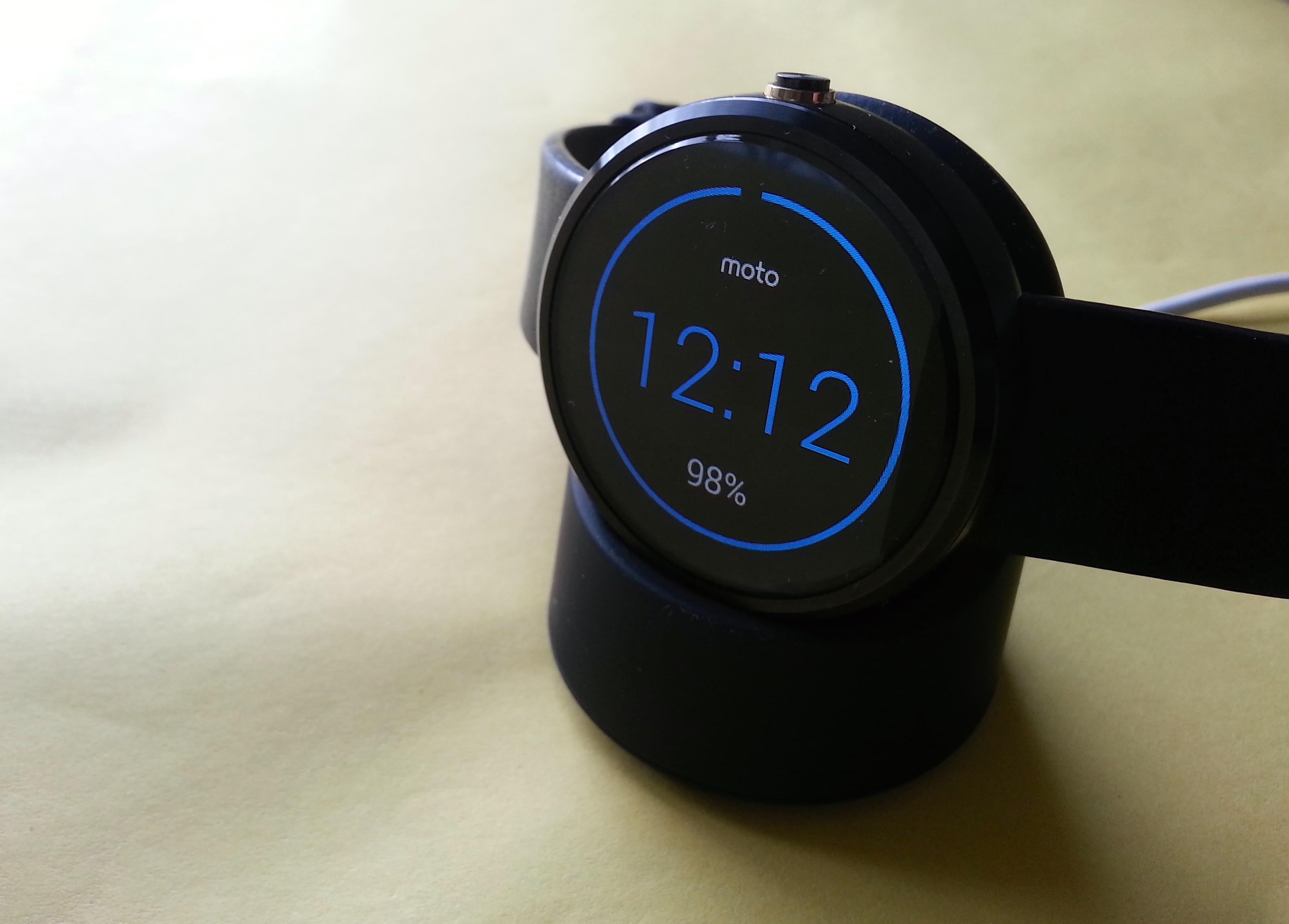 The Moto 360 in its charging cradle