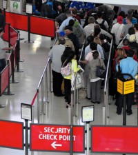 Travelers on line at JFK's Terminal 1 TSA security checkpoint