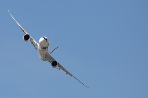 The A350-900 makes a sweeping turn during a demonstration flight over the Farnborough Airshow in 2014