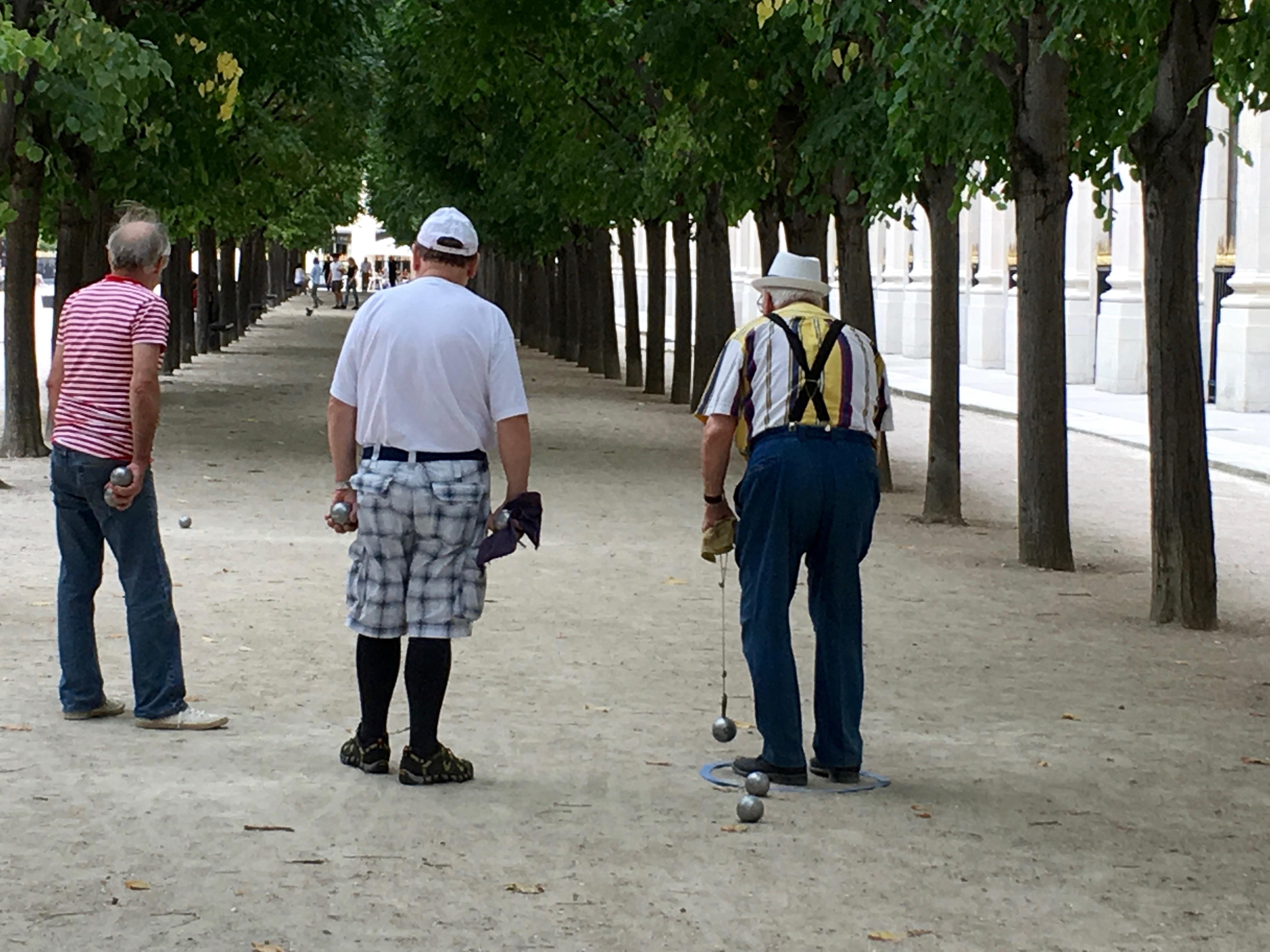 Parisians playing petanque in a park